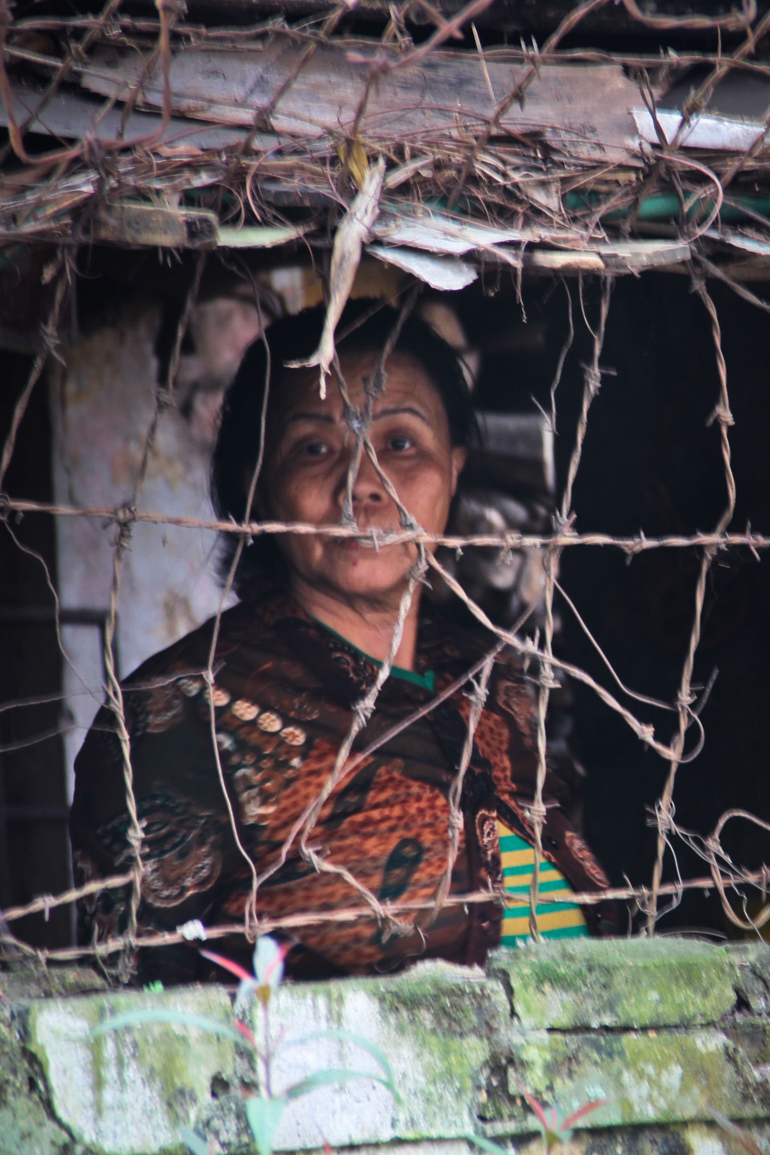 woman behind barbed wire